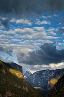 Cumulus clouds in spring over El Capitan and Half Dome, Yosemite Valley, Yosemite National Park, California