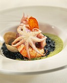 Rice with squid ink,gamba,poulpe and watercress emulsion