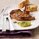 Veal chop with garlic and parsley sauce