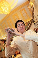 A male bartender working in the bar of Hotel Sofitel Macau at Ponte 16  Macau  China.