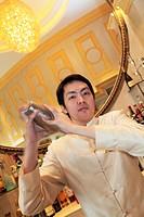 A male bartender working in the bar of Hotel Sofitel Macau at Ponte 16  Macau  China.