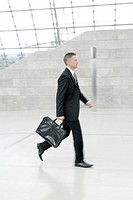 businessman walking through hall