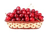 cherries in a basket isolated on white