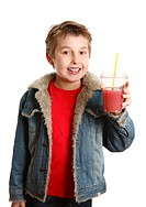 Happy healthy boy holding fresh fruit juice in clear cup
