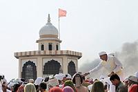 Bishnoi pilgrims making donations, Jambeshwar festival, Samrathal Dhora, Rajasthan, India