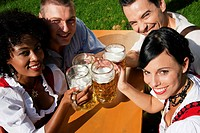 Group of four friends in beer garden