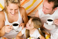 Family breakfasting in bed