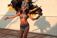 Samba dance in carnival costume on building site