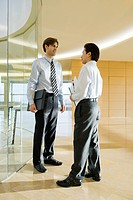 Businessmen talking in corridor