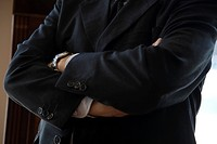 Executive with arms folded, cropped (thumbnail)