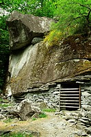 splui di inselmitt historic traditional goat shelter under stone boulder - near settlement of sabbione - bavona valley - canton of ticino - switzerlan...