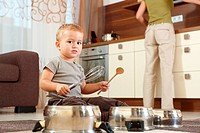 Little boy playing in kitchen