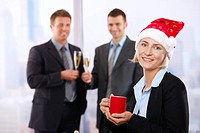 Businesswoman in Santa Claus hat