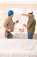 Builder and architect in discussion