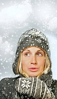 Young woman with snowy winter theme background