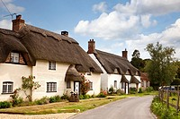 Row of traditional detached thatched cottages, Tarrant Monkton, Dorset, England, UK