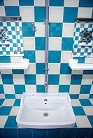 Bathroom with blue and white tiles