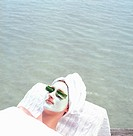 Young Woman with Face Mask _ Wellness