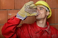 Building worker drinking water