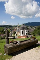 Austria, Mondsee city, Water trough with city in background