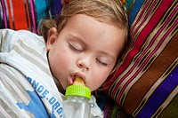 Sleeping boy with bottle