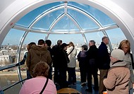 Passengers in a London Eye pod above London