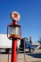 A modern truck passes by a vintage Texaco gas pump in Lakeland, Georgia, USA