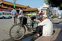 Man selling fruit from the back of his tricycle on the roadside, Datong, Shanxi, China.