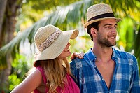 Couple standing in tropical resort