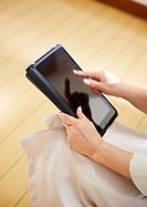 Senior woman´s hands using tablet PC