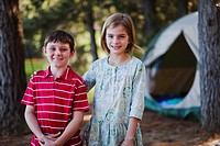 Children standing together at campsite