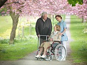 Older couple with caretaker in park