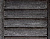 weathered planks of wood on shed wall.