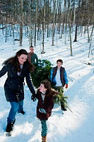 Family walking in snow