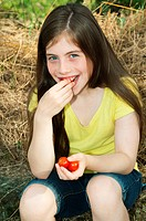 Girl eating cherry tomatoes
