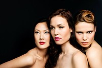 Three women wearing lipstick, portrait