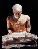 Egyptian civilization, Old Kingdom, Dynasty IV. Painted limestone statuette of a scribe seated. From Giza.  Cairo, Egyptian Museum