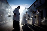 An acolyte spreads incense during an Easter Holy Week procession in Prado del Rey, Andalusia, Spain, April 24, 2011