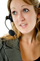 Young woman with headset doing phone support
