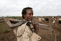 Ethiopian shepherd protects his herd with a gun