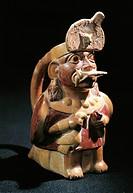 Pre-Inca civilization, Peru, 4th-9th century A.D. Moche culture. Anthropomorphic polychrome terracotta vessel in shape of priest holding sacrificial a...