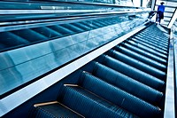 Moving up escalator in trade center