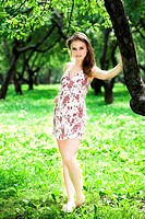 Girl stay in dress in park