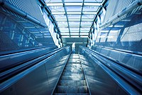 Blue move escalator in modern office centre