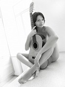 adult pretty woman portrait with guitar