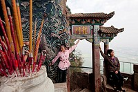 Visitors having photos taken in front of Historical Dragon Gate on Western Mountain over look Dian Lake Dianchi  Kunming  China.