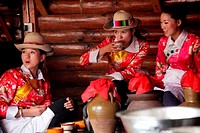 Mosuo girls in traditional dress in Yunnan Ethnic Village  Kunming  China
