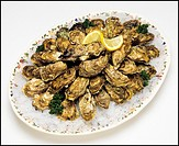 French Normandy oysters with ice on platter