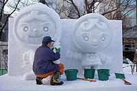 Preparing the Sapporo snow festival,snow sculptures,Odori Park, Sapporo, Hokkaido, Japan