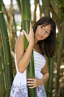 Latin woman in bamboo forest
